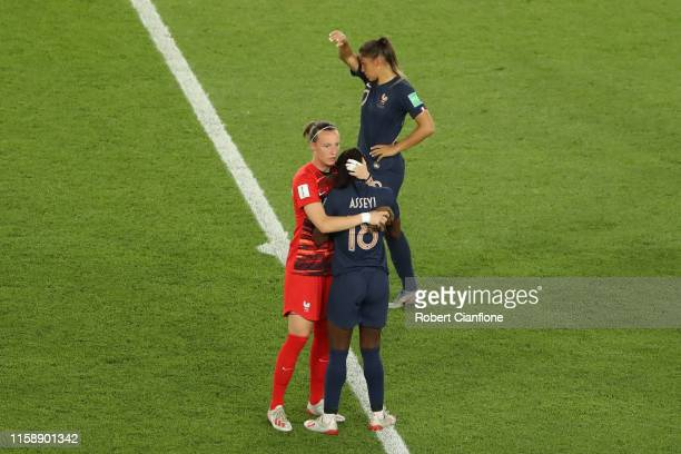 Pauline PeyraudMagnin of France consoles teammate Viviane Asseyi following their team's defeat in the 2019 FIFA Women's World Cup France Quarter...