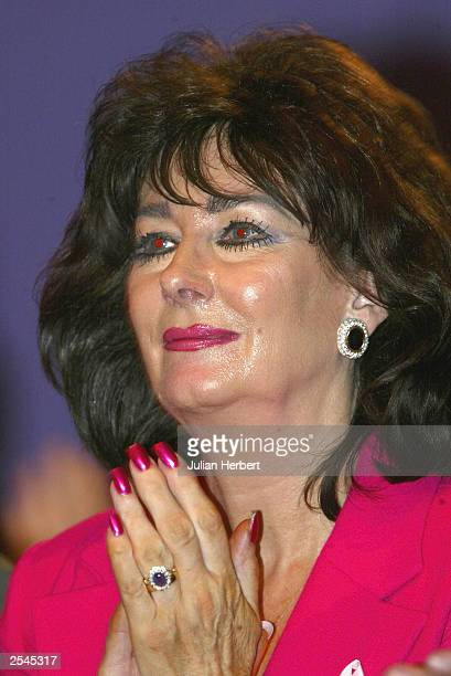 Pauline Prescott the wife of Britains Deputy Prime Minister John Prescott applauds her husbands speech at The Labour Party Annual Conference on...