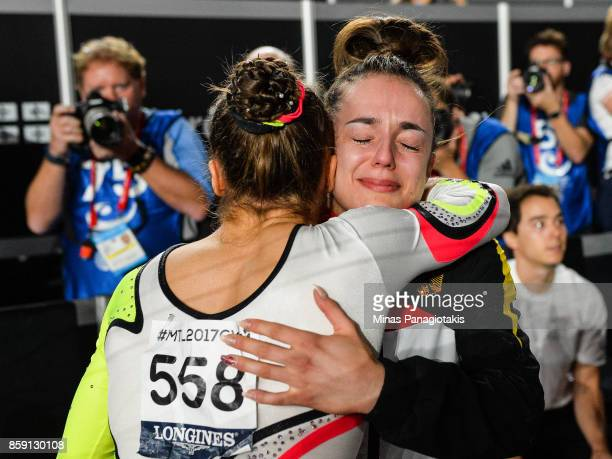 Pauline Schaefer of Germany and Tabea Alt of Germany hug it out after placing first and third on the balance beam during the individual apparatus...