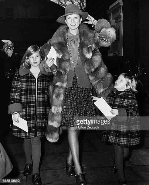 Pauline Stone the widow of actor Laurence Harvey leaves St Paul's Church Covent Garden with her children Sophie and Domino after attending the...