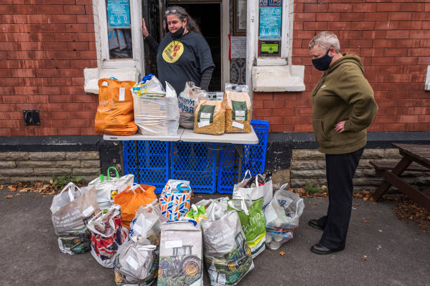 GBR: Donations Are Received At We Shall Overcome Food Bank In The Station Pub