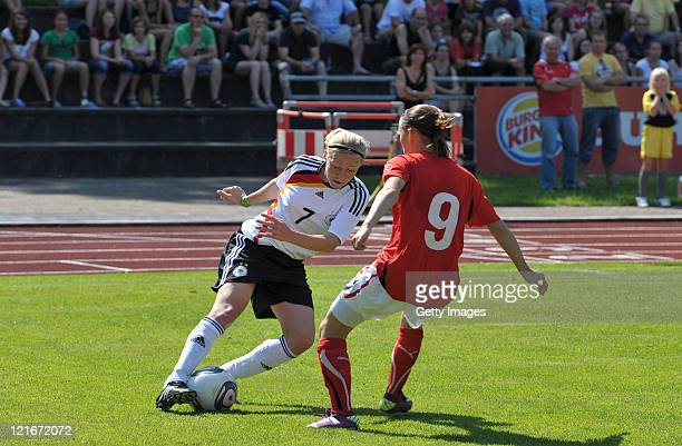 PaulineMarie Bremer of Germany and Claudia Wasser of Austria battle for the ball during a Women International friendly match between U16 Germany and...