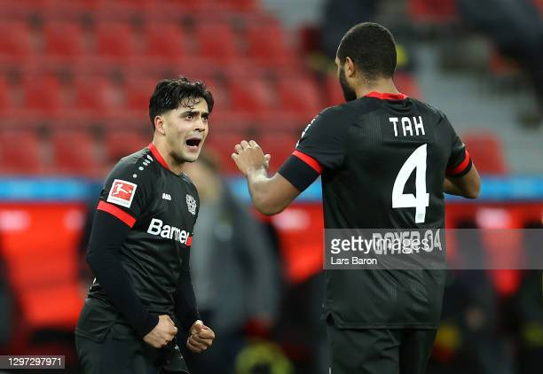 Paulinho and Jonathan Tah of Bayer 04 Leverkusen celebrate following their side's victory in the Bundesliga match between Bayer 04 Leverkusen and...