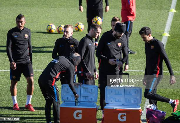 Paulinho and Sergio Busquets are seen training during an open public session held at the Barcelona Ministadium on January 5 2018 in Barcelona Spain