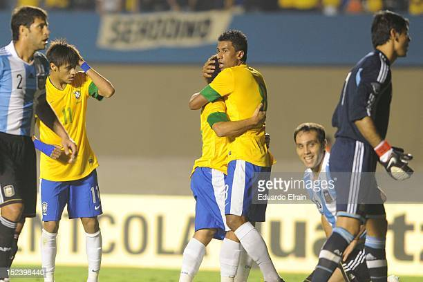 Paulinho and Wellington of Brazil in action during the first leg of the Superclasico de las Américas between Brazil and Argentina at Estádio Serra...
