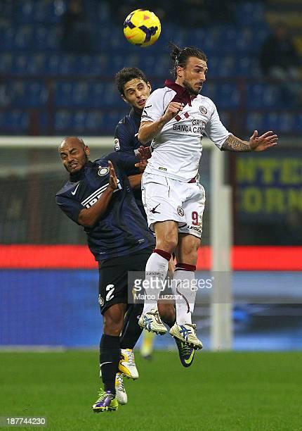 Paulinho Bettanin Paulo Sergio of AS Livorno Calcio competes for the ball with Andrea Ranocchia and Cicero Moreira Jonathan of FC Internazionale...