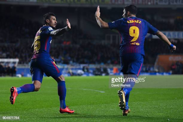 Paulinho Bezerra of FC Barcelona celebrates with his team mate Luis Suarez after scoring his team's first goal during the La Liga match between Real...