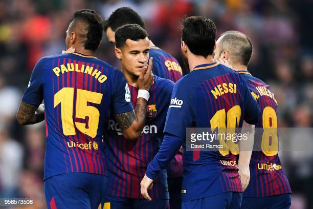 Paulinho Bezerra of FC Barcelona celebrates with his team mate Philippe Coutinho after scoring his team's second goal during the La Liga match...