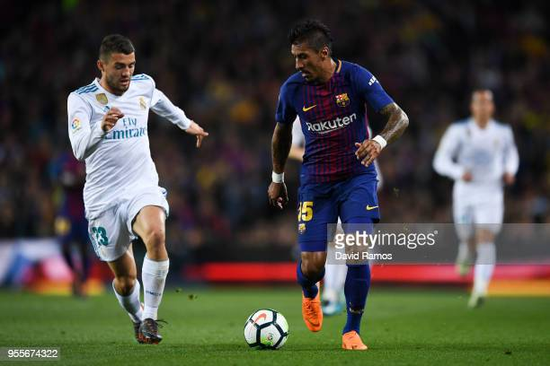 Paulinho Bezerra of FC Barcelona competes for the ball with Mateo Kovacic of Real Madrid CF during the La Liga match between Barcelona and Real...