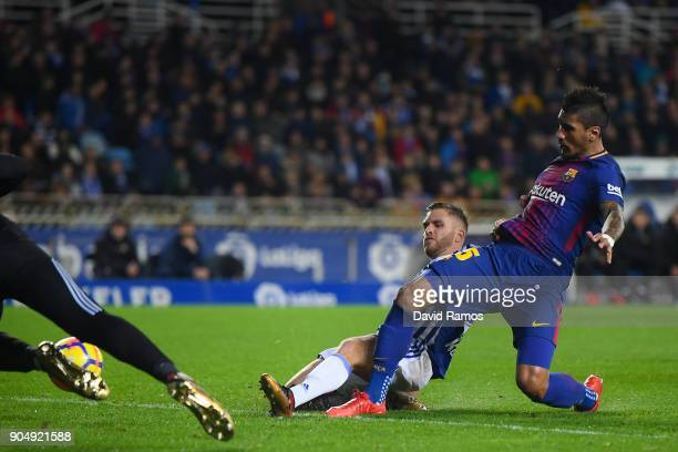 Paulinho Bezerra of FC Barcelona scores his team's first goal during the La Liga match between Real Sociedad and FC Barcelona at Anoeta stadium on...
