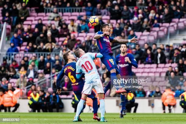 Paulinho Maciel of FC Barcelona fights for the ball with Iago Aspas Juncal of RC Celta de Vigo during the La Liga 201718 match between FC Barcelona...