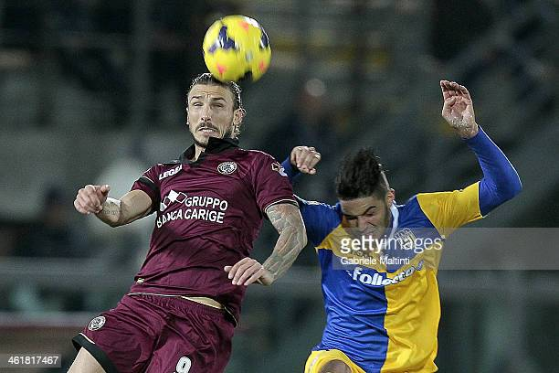 Paulinho of AS Livorno Calcio fights for the ball with Pedro Mendes of Parma FC during the Serie A match between AS Livorno Calcio and Parma FC at...