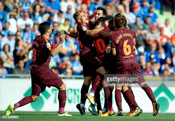 Paulinho of Barcelona celebrates scoring his team's second goal with his teammates during the La Liga match between Getafe and Barcelona at Coliseum...
