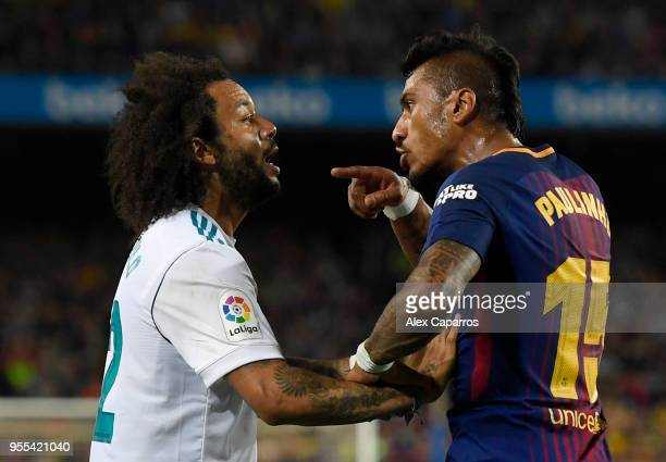 Paulinho of Barcelona clashes with Marcelo of Real Madrid during the La Liga match between Barcelona and Real Madrid at Camp Nou on May 6 2018 in...