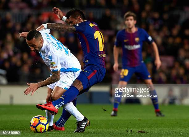 Paulinho of Barcelona competes for the ball with Guilherme dos Santos of Deportivo de La Coruna during the La Liga match between Barcelona and...