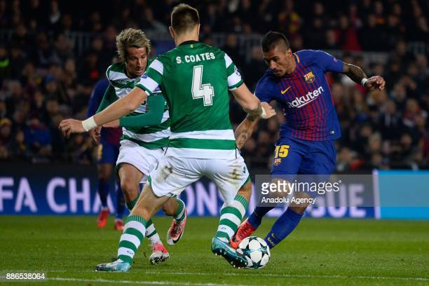 Paulinho of Barcelona in action against Sebastian Coates and Fabio Coentrao of Sporting CP during the UEFA Champions League Group C soccer match...