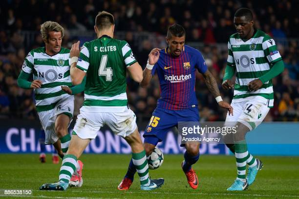 Paulinho of Barcelona in action against Sebastian Coates Fabio Coentrao and William Carvalho of Sporting CP during the UEFA Champions League Group C...