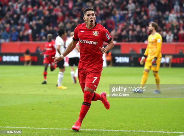 Paulinho of Bayer 04 Leverkusen celebrates scoring his team's fourth goal during the Bundesliga match between Bayer 04 Leverkusen and Eintracht...