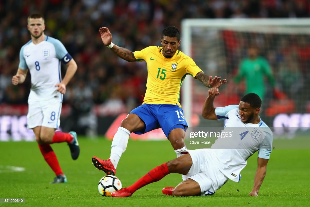 Paulinho of Brazil and Joe Gomez of England battle for possession during the international friendly match between England and Brazil at Wembley Stadium on November 14, 2017 in London, England.