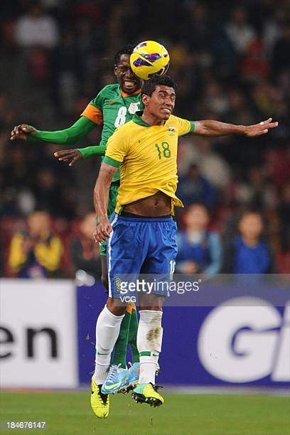 Paulinho of Brazil and Kondwani Mtonga of Zambia battle for the ball during the international friendly match between Brazil and Zambia at Beijing...