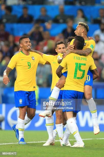 Paulinho of Brazil celebrate scoring the opening goal with Gabriel Jesus of Brazil, Philippe Coutinho of Brazil and Neymar of Brazil during the 2018...