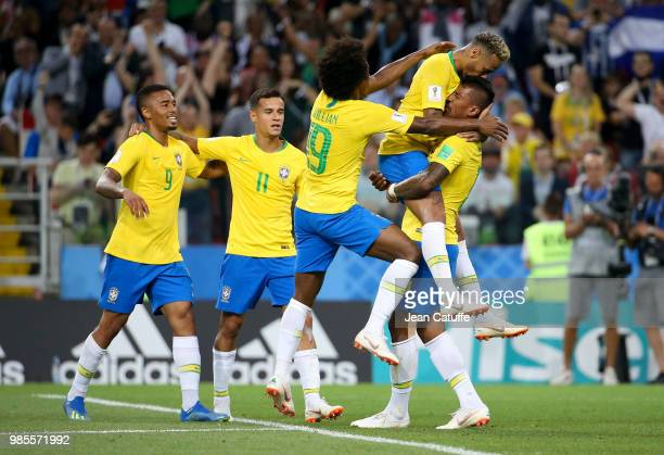 Paulinho of Brazil celebrates his goal with Neymar Jr from left Gabriel Jesus Philippe Coutinho Willian during the 2018 FIFA World Cup Russia group E...