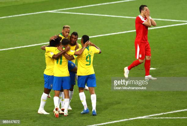 Paulinho of Brazil celebrates with teammates after scoring his team's first goal during the 2018 FIFA World Cup Russia group E match between Serbia...