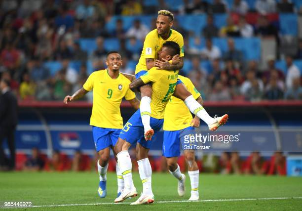 Paulinho of Brazil celebrates with teammates Neymar Jr and Gabriel Jesus after scoring his team's first goal during the 2018 FIFA World Cup Russia...