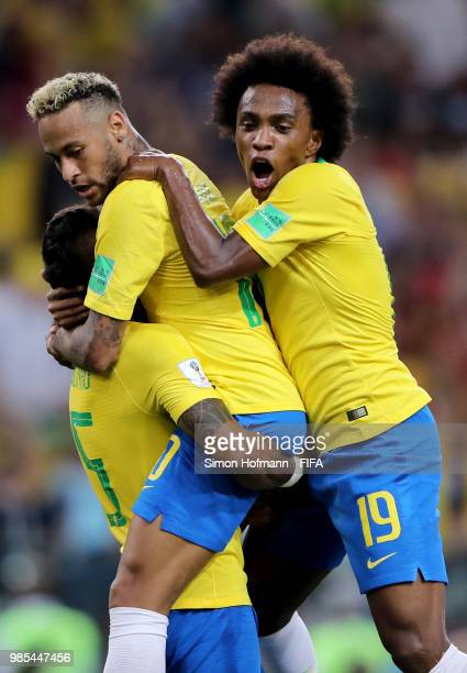 Paulinho of Brazil celebrates with teammates Neymar Jr and Willian after scoring his team's first goal during the 2018 FIFA World Cup Russia group E...