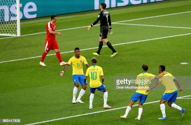 Paulinho of Brazil celebrates with teammates Neymar Jr Philippe Coutinho and Gabriel Jesus after scoring his team's first goal during the 2018 FIFA...