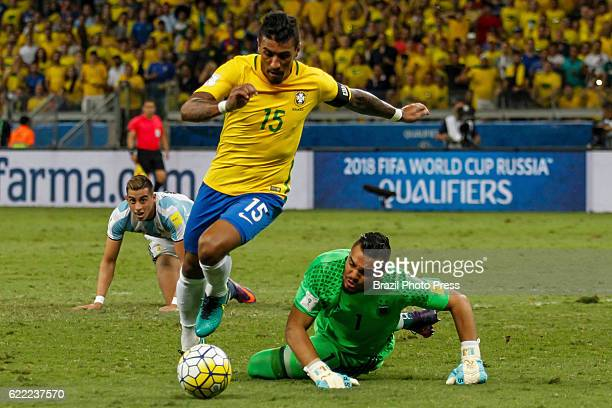 Paulinho of Brazil drives the ball past Sergio Romero goalkeeper of Argentina during a match between Argentina and Brazil as part of FIFA 2018 World...