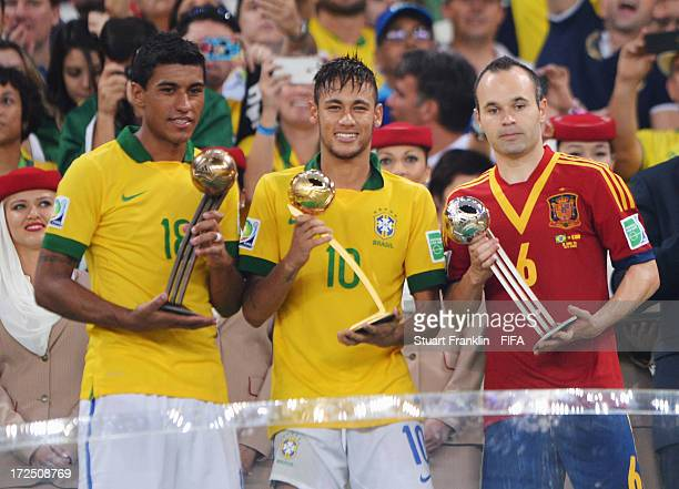 Paulinho of Brazil holds the adidas Bronze Ball award Neymar of Brazil holds the adidas Golden Ball award and Andres Iniesta of Spain holds the...