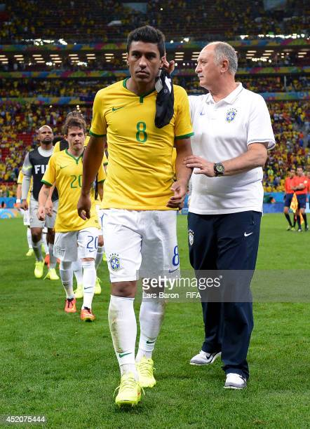 Paulinho of Brazil is consoled by head coach Luiz Felipe Scolari of Brazil after the 2014 FIFA World Cup Brazil 3rd Place Playoff match between...