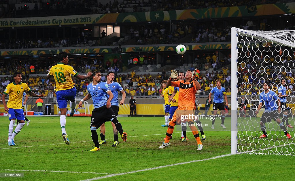 Paulinho of Brazil (18) scores their second goal past goalkeeper Fernando Muslera of Uruguay during the FIFA Confederations Cup Brazil 2013 Semi Final match between Brazil and Uruguay at Governador Magalhaes Pinto Estadio Mineirao on June 26, 2013 in Belo Horizonte, Brazil.