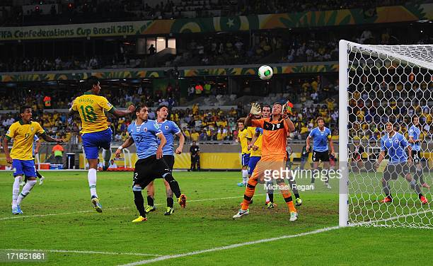 Paulinho of Brazil scores their second goal past goalkeeper Fernando Muslera of Uruguay during the FIFA Confederations Cup Brazil 2013 Semi Final...