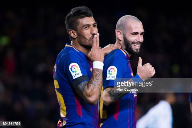 Paulinho of FC Barcelona celebrates with his teammate Aleix Vidal after scoring his team's fourth goal during the La Liga match between FC Barcelona...