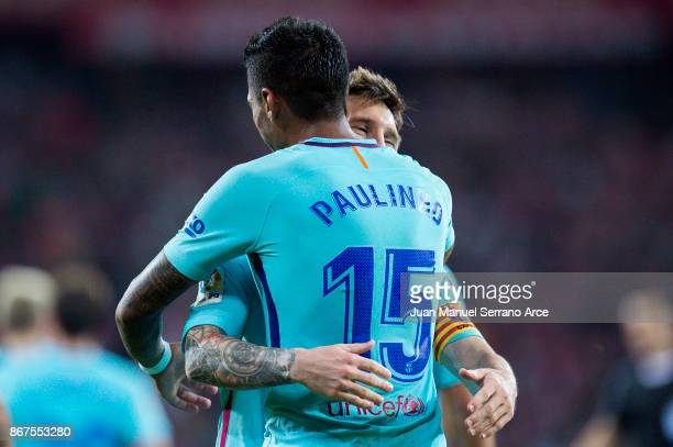 Paulinho of FC Barcelona celebrates with his teammates Lionel Messi of FC Barcelona after scoring his team's second goal during the La Liga match...