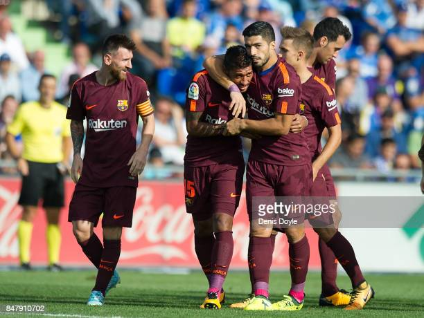 Paulinho of FC Barcelona celebrates with Luis Suarez after scoring his team's 2nd goal during the La Liga match between Getafe and Barcelona at...