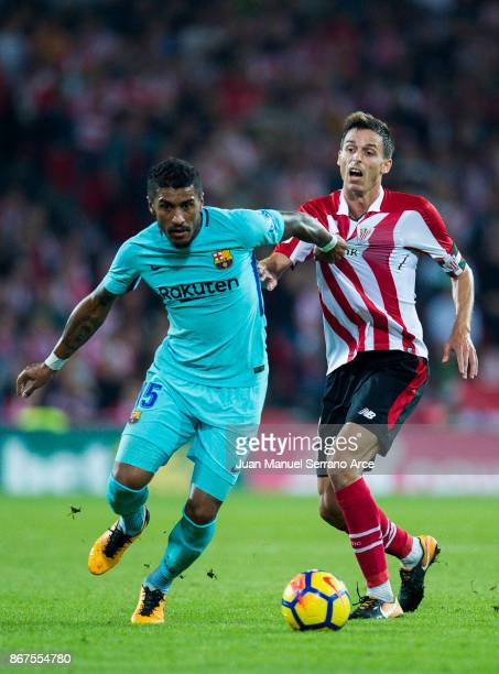 Paulinho of FC Barcelona competes for the ball with Ander Iturraspe of Athletic Club during the La Liga match between Athletic Club Bilbao and FC...