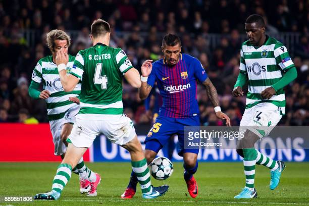 Paulinho of FC Barcelona competes for the ball with Fabio Coentrao Sebastian Coates and William Carvalho of Sporting CP during the UEFA Champions...