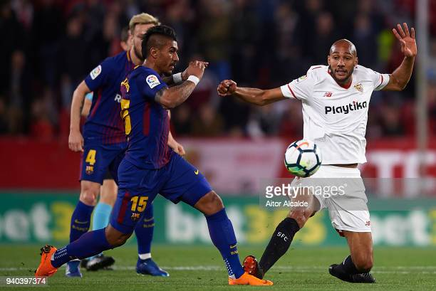 Paulinho of FC Barcelona competes for the ball with Steven N'Zonzi of Sevilla FC during the La Liga match between Sevilla CF and FC Barcelona at...