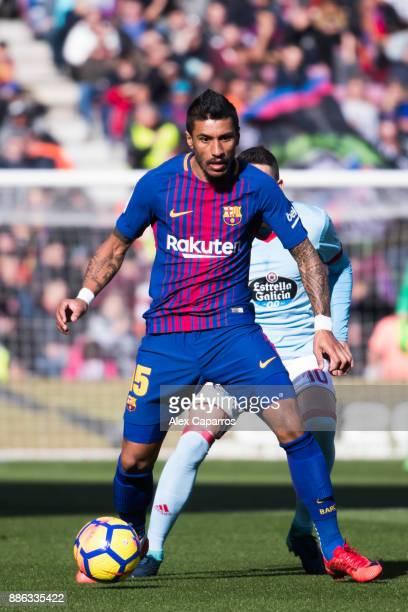 Paulinho of FC Barcelona controls the ball under pressure from Iago Aspas of Celta de Vigo during the La Liga match between FC Barcelona and Celta de...