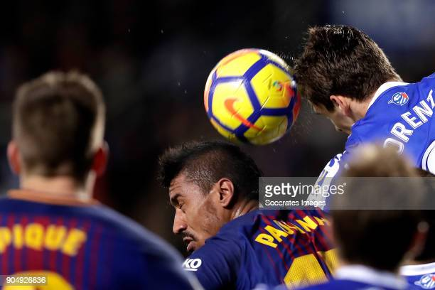 Paulinho of FC Barcelona Diego Llorente of Real Sociedad during the La Liga Santander match between Real Sociedad v FC Barcelona at the Estadio...