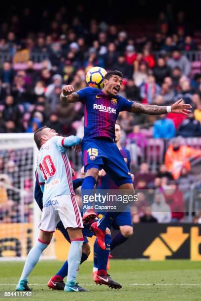 Paulinho of FC Barcelona heads the ball under pressure from Iago Aspas of Celta de Vigo during the La Liga match between FC Barcelona and Celta de...