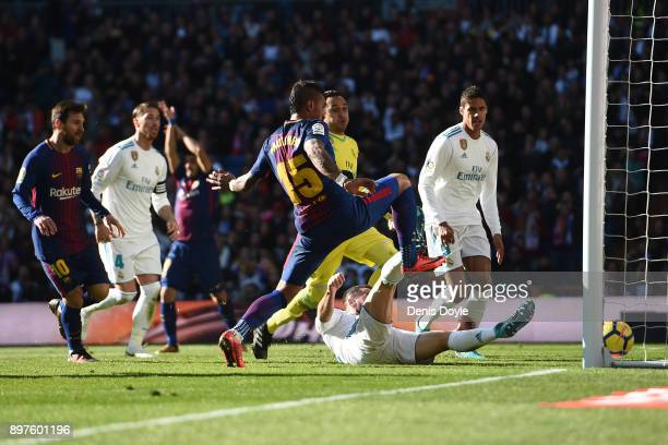 Paulinho of FC Barcelona is fouled by Dani Carvajal of Real Madrid during the La Liga match between Real Madrid and Barcelona at Estadio Santiago...