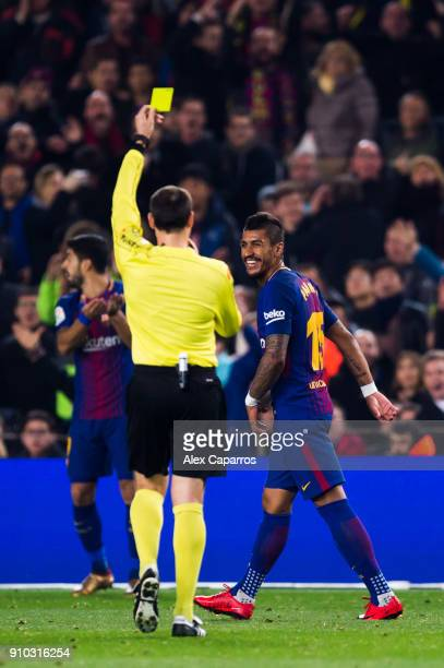 Paulinho of FC Barcelona is shown a yellow card by referee Antonio Miguel Mateu Lahoz during the Spanish Copa del Rey Quarter Final Second Leg match...