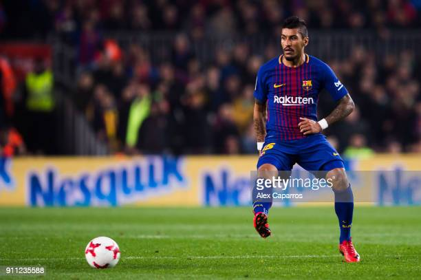 Paulinho of FC Barcelona plays the ball during the Spanish Copa del Rey Quarter Final Second Leg match between FC Barcelona and RCD Espanyol at Camp...
