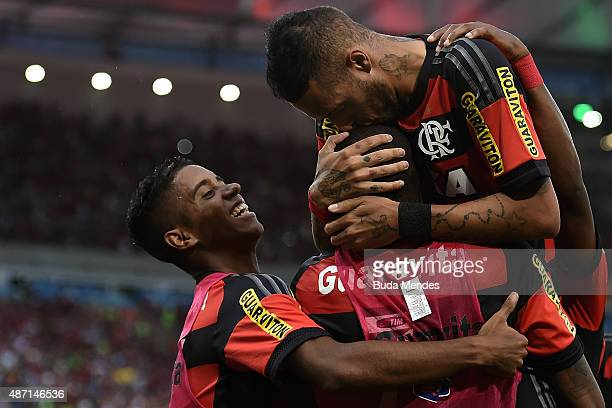 Paulinho of Flamengo celebrates after scoring a goal during a match between Flamengo and Fluminense as part of Brasileirao Series A 2015 at Maracana...
