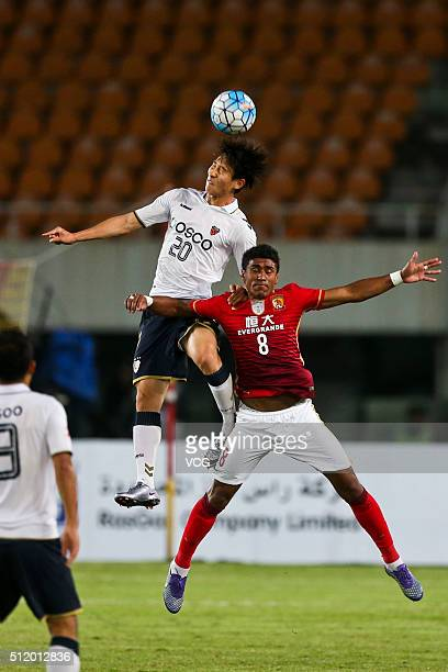 Paulinho of Guangzhou Evergrande and Choe Hoju of Pohang Steelers compete for the ball during the AFC Champions League Group H match between...