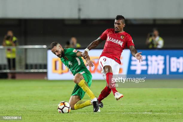 Talisca of Guangzhou Evergrande celebrates with Paulinho after scoring a goal during 2018 Chinese Super League 12th round match between Guangzhou...